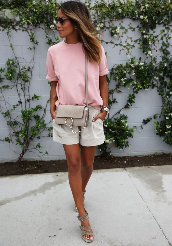 Solid colours are always a great summer look - especially when they're this pink tee combined with beige shorts! Via Julie Sarinana Shops: Not Specified