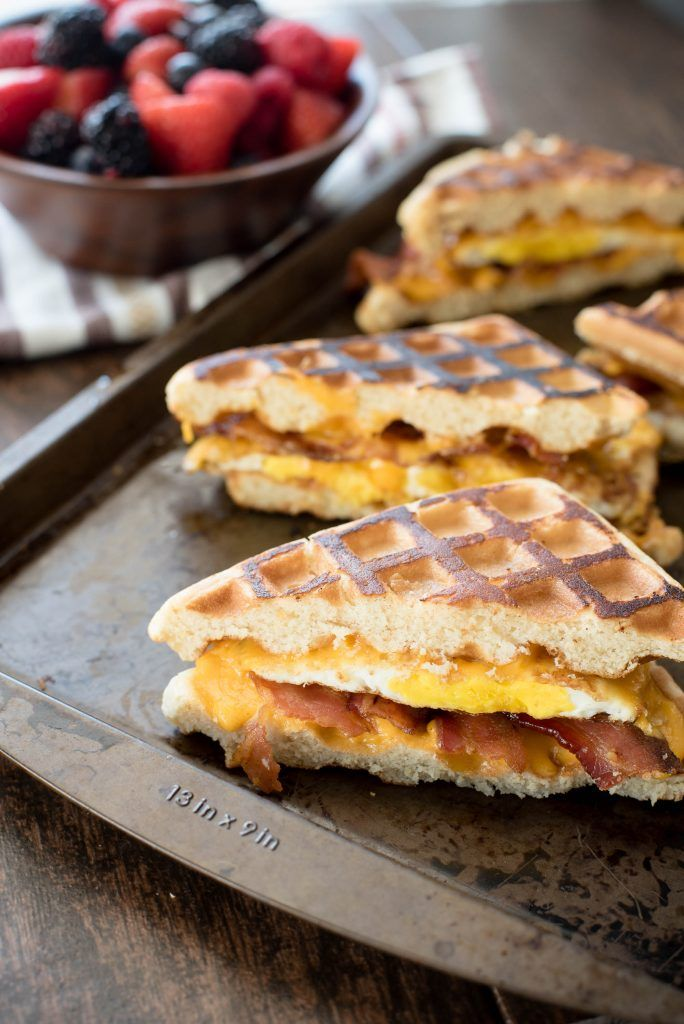 Grilled Waffle Breakfast Sandwich. Breakfast never tasted so good with this amazing grilled cheese breakfast sandwich made with waffles instead of bread. Yum!