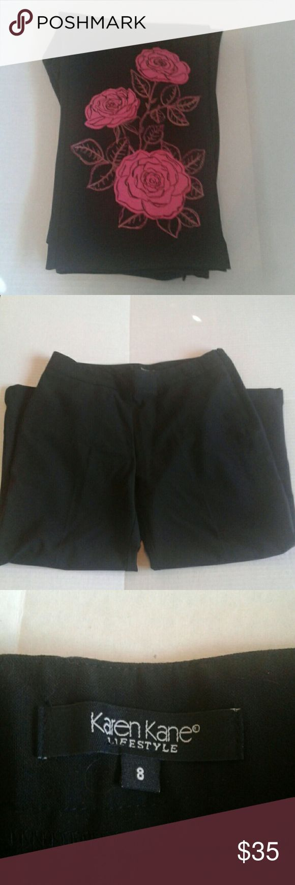 Karen Kane Capri pants with flowers This is a pair of black Karen Kane Capri pants with pink flowers on the bottom of one leg. They are a size 8 and are NWOT. Thanks so much for shopping with me on Postmark! Karen Kane Pants Capris