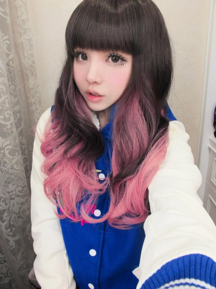 Long curly hair with straight bangs, brown color with pink dyed hair underneath.  Hair: Long