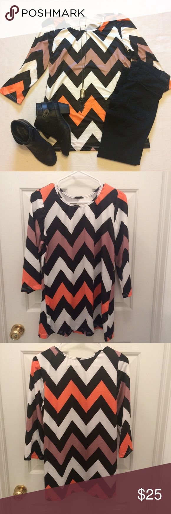 Adorable chevron top Black, tan, orange, and white chevron top. True to size. Super flattering fit. No trades. Price is firm. Tops Blouses