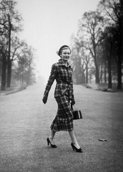 February 1948 A woman models a two-piece tailored suit, with the new look length in the skirt. Photo by Bert Hardy/Picture Post/Getty Images