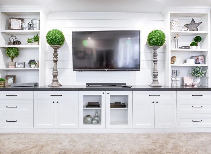 This Sundance door entertainment center is our top viewed design on Pinterest (over 147k views!) You can find more design inspiration over at Pinteres…