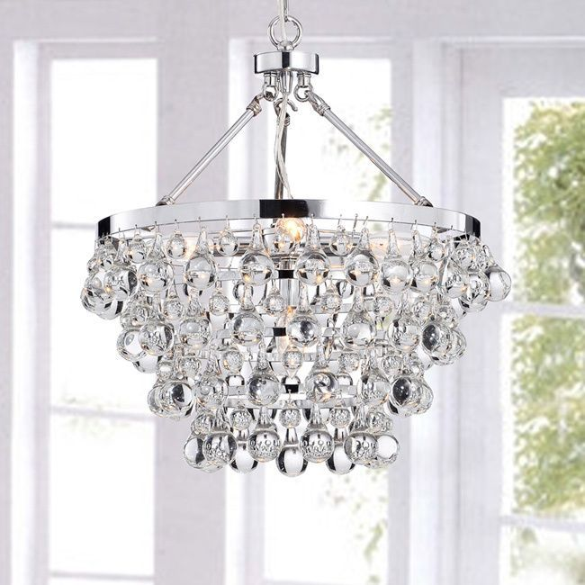Update your living room or dining room with this beautiful five light contemporary crystal chandelier. Featuring a gleaming chrome finish and sparkling clear crystal drops, this modern chandelier comes equipped with a 40-inch hanging wire.
