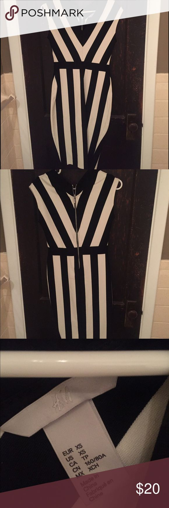 H&M V-neck black and white bodycon dress Awesome dress worn once! Tons of compliments. Super edgy and fun! In great condition! H&M Dresses Midi
