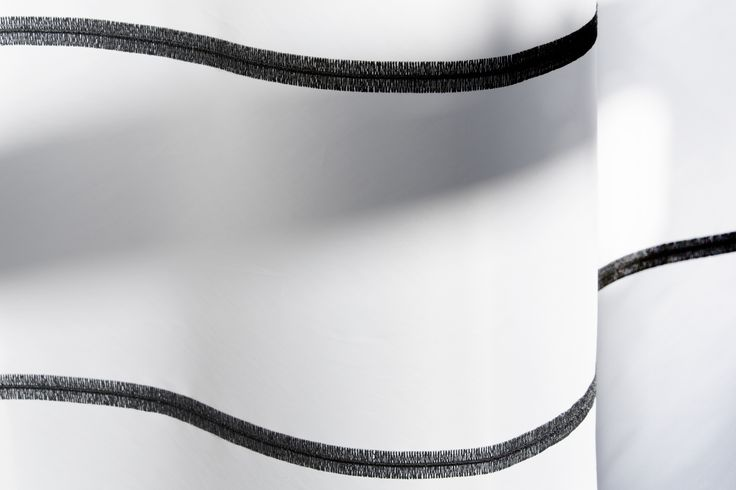 Minimalistic SEAMER has the look of a magnified giant stitched line.