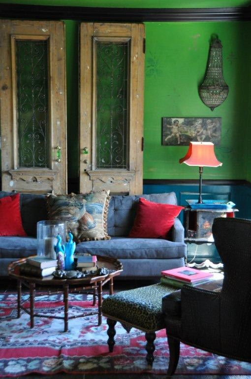 emerald wall and vintage furnishings