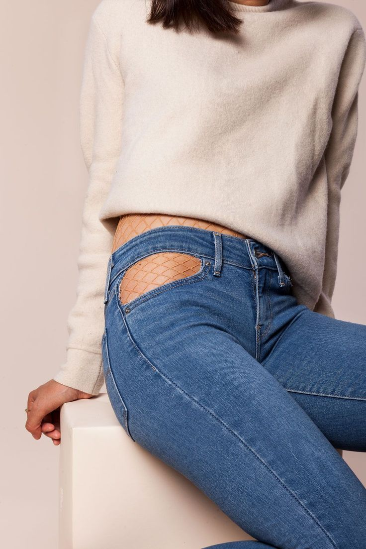 The Pocket CutoutAdd some interest to the typical medium-wash skinny jean by taking scissors to the pockets for a peekaboo effect. If you don't want to show bare skin, they're great for layering over fishnets or other fun tights for fall.Aritzia sweater; Levi's jeans. #refinery29 http://www.refinery29.com/how-to-wear-skinny-jeans-diy-ideas#slide-4