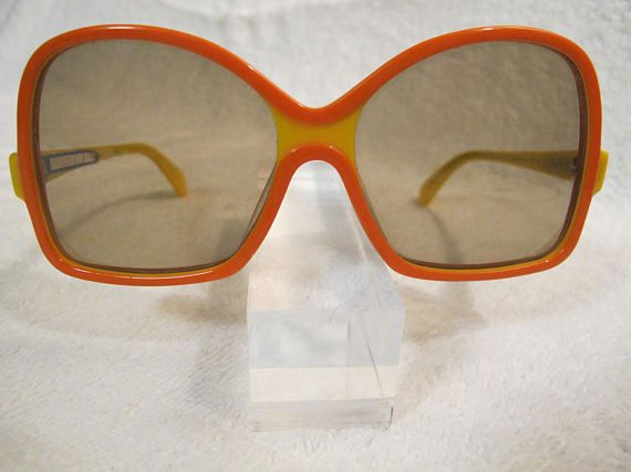 ***NOS (New Old Stock)***  *** Direct from Opticians Collection***  RODENSTOCK! Made in Germany SWEET Mod FUN!!  •1960s SUNGLASSES •MFG: RODENSTOCK •MADE IN GERMANY •MOD: MANILA •SIZE: 58-15-130 •COLOR: SWEET (yellow / orange)  **Original MFG Sticker inside arm**   NO REFUNDS or RETURNS!! Please review measurements for fit PRIOR to purchase!!  Dont let these BEAUTIES get away. Take a look around our Shop for MORE FUN Finds