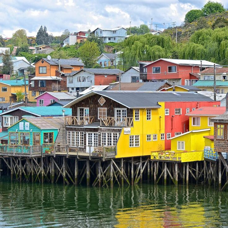 These stilt houses (or palafitos) are built over water on Chiloe Island. What color would you choose for your home? Photo by @kikeo by sandisk