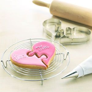 Um, yeah, I'm buying these -- Heart Puzzle Cookie Cutters -- so cute for a bridal shower or something!