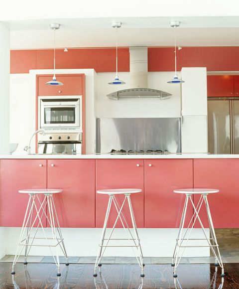 This kitchen's soft salmon cabinets have a subtle, but eye-catching, effect.