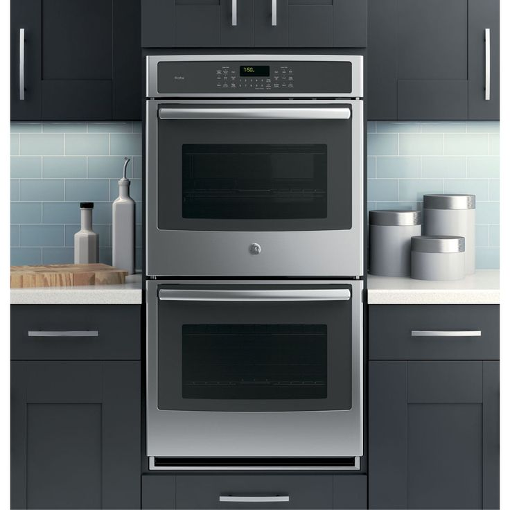 GE Profile Series 27-inch Built-in Double Convection Wall Oven. Made with a stainless steel finish and arrives assembled. According to Federal Law Magnuson-Moss Warranty Act (P.L. 93-637) All Applianc