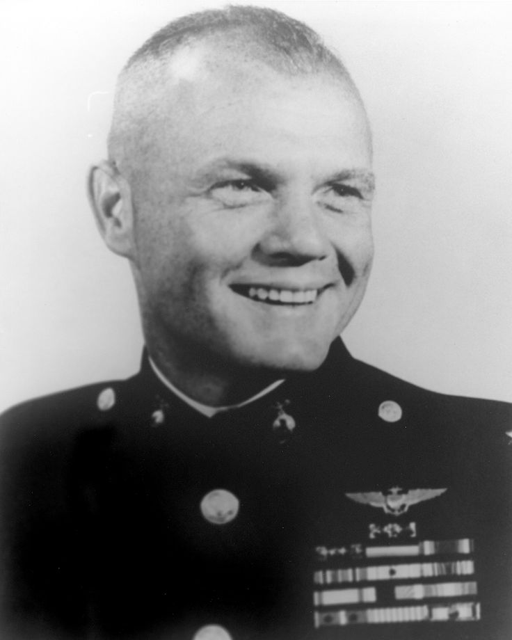 Col. John H. Glenn, Jr., U.S. Marine Corps 1941-65 WW II, Korean War. Corsair Fighter Pilot. Astronaught. Earned five Distinguished Flying Crosses, six Air Medals, and Congressional Space Medal of Honor. U.S. Senator (D-OH) 1974-99.