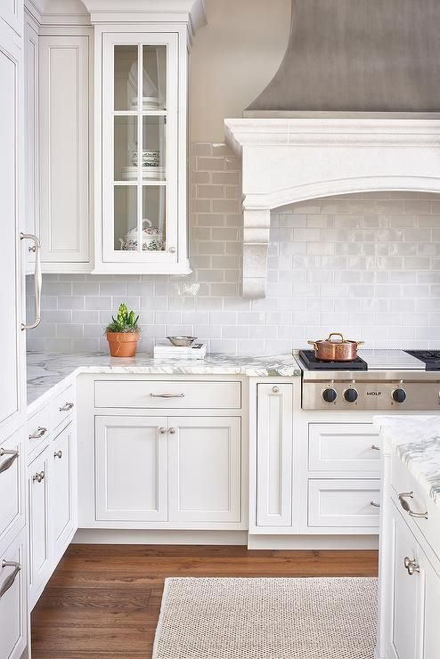 White And Gray Kitchen Features A Zinc French Kitchen Hood With Corbels  Stands Over A Gray