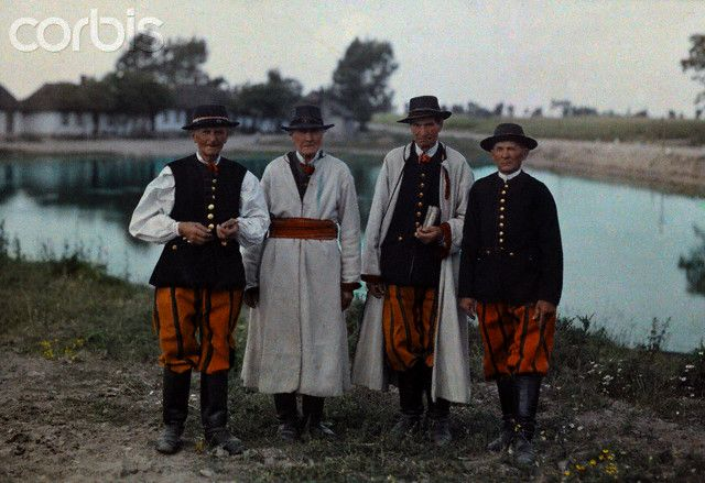1933, Poland --- Portrait of Zduny peasants wearing white capotes and striped trousers --- Image by © Hans Hildenbrand/National Geographic Society/Corbis