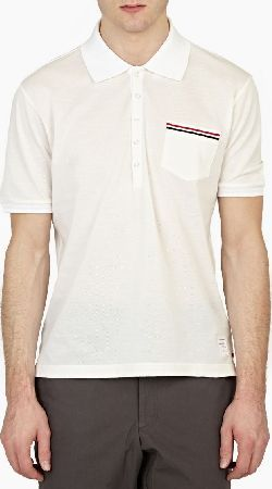 Thom Browne Off-White Cotton-Pique Polo Shirt The Thom Browne Cotton-Pique Polo Shirt for AW15, seen here in off-white. - - - A classic style from Thom Browne each season, this polo shirt is presented in a unique off-white shade and finished with http://www.comparestoreprices.co.uk/january-2017-6/thom-browne-off-white-cotton-pique-polo-shirt.asp