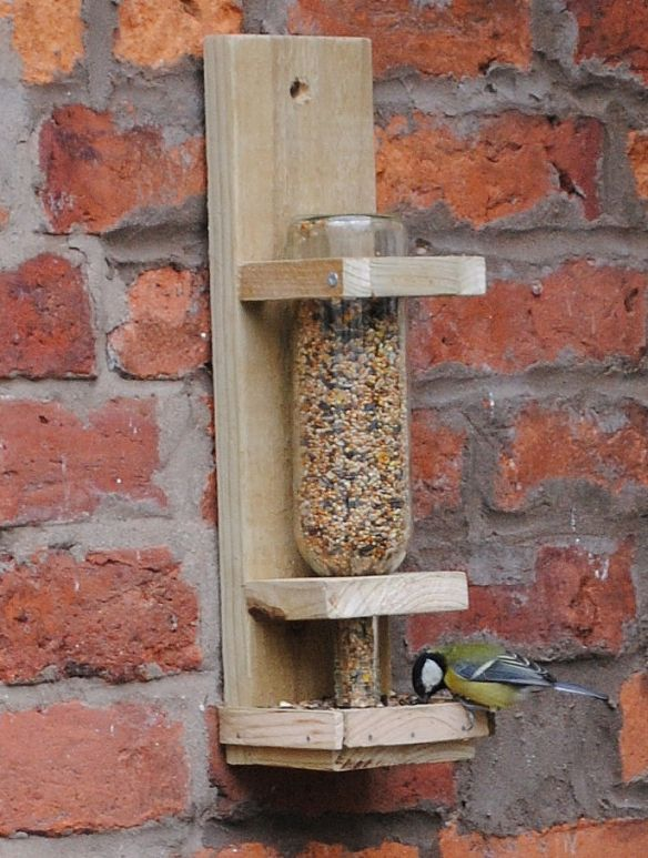 bottle bird feeder with wood holder to make! Might need wire around the bottom to keep squirrels out.