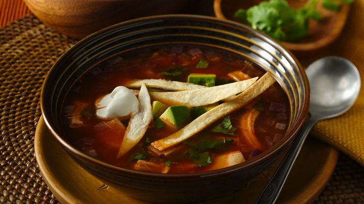 This soup comes together in no time!  Crunchy tortilla strips add some great texture for a perfect lunch or dinner.
