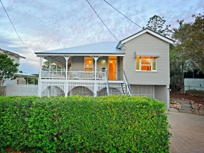 Another View Of The Grey Painted Queenslander With White