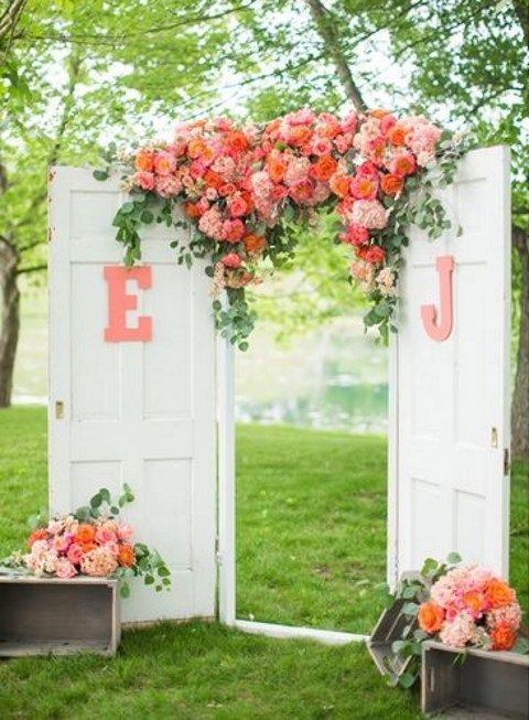 I think tgis what her doors will look like tgat she rents. vintage doors and lush florals for a wedding aisle entrance  ~  we ❤ this! moncheribridals.com