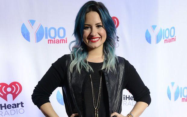 """Mesmo tendo que passar o ano se dedicando a sua The Neon Lights Tour, Demi Lovato prometeu um álbum novo para 2014, assim que anunciou sua saída do The X Factor. """"Tudo tem sido ótimo, mas estou muito animada para 2014. Vou me dedicar completamente e inteiramente à música. Sair em turnê e fazer um novo álbum. Possivelmente lançar um novo trabalho"""", declarou a cantora na ocasião, para a alegria dos Lovatics."""