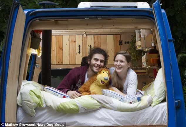 Hidden world: Claire Bragg, 25, and Stuart Humphreys, 24, spent £6,000 converting this second-hand van into a mobile home