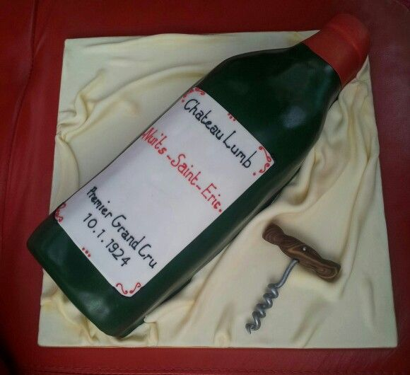 A very large bottle of wine in cake form #winebottle #cake #birthday www.sugarcloud cakes.co.uk