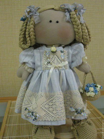 Купить или заказать Кукла текстильная Агния в интернет-магазине на Ярмарке Мастеров. Ручная работа. Кукла текстильная. Сшита из кукольного трикотажа. Наполнитель-синтепух .Крепление ручек и ножек нитяное .Головка пришивная. Волосы заплетены в косы из хб ниток.В косы вплетены шебби ленты. Одежда сшита вручную(платье и панталоны) из натуральных тканей .Украшена кружевом,лентами и цветами .Обувь связана крючком из х/.б ниток.В ручке вязаная корзинка с цветами .
