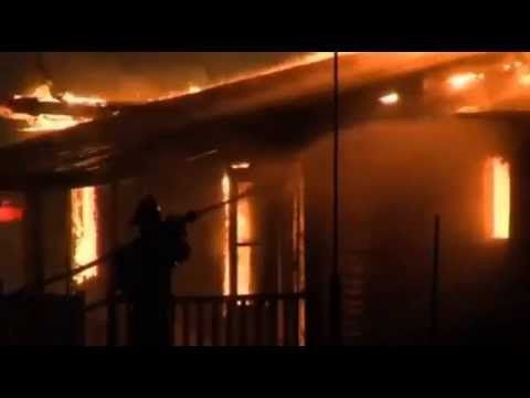 Fire crews battle a house fire in Indiana