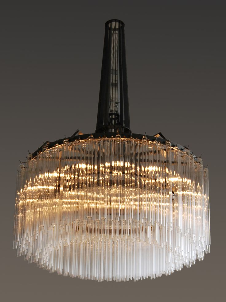 LAMPADARIO EAGLE / EAGLE CHANDELIER sizes 97 x 97 x 130 cm Eagle Chandelier made with steel frame and glass tubes. Equipped with black iron ceiling rose. Orvett Design