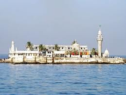 Haji Ali Dargah, Mumbai - India  The Haji Ali Dargah is a mosque and dargah located on an islet off the coast of Worli in the Southern part of Mumbai. Near the heart of the city proper, the dargah is one of the most recognisable landmarks of Mumbai