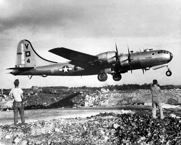 Two U.S. soldiers watching the takeoff of a B-29 bomber from the air base at Saipan, destination Tokyo. Saipan, 23rd November 1944