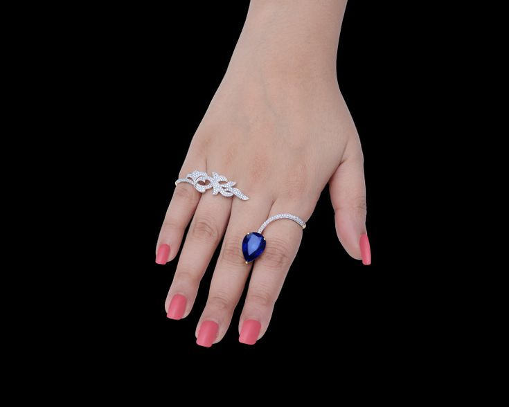A cocktail #palmcuff with a brilliant blue #gemstone is the perfect pick for an elegant evening!
