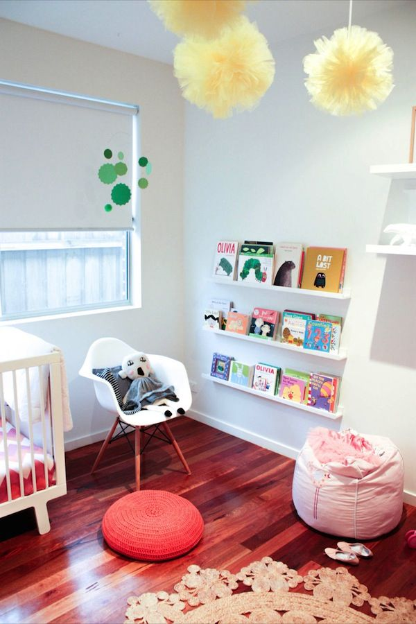 this kids room is super cute! love the picture ledge as bookshelf- makes more sense, since little ones identify their favorites by covers, not spines!