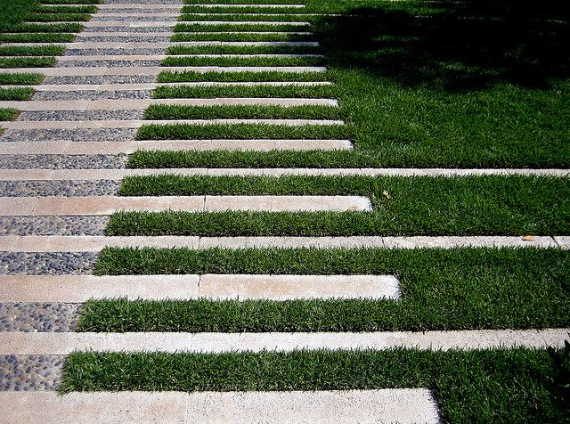 Paved path through lawn. Pinned to Garden Design - Paving & Stairs by Darin Bradbury.