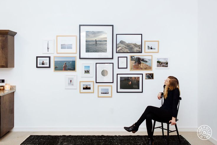 12 Gallery Wall Styles for Any Space - Hang bigger items in the middle of your gallery wall and filling the outer edges with smaller frames
