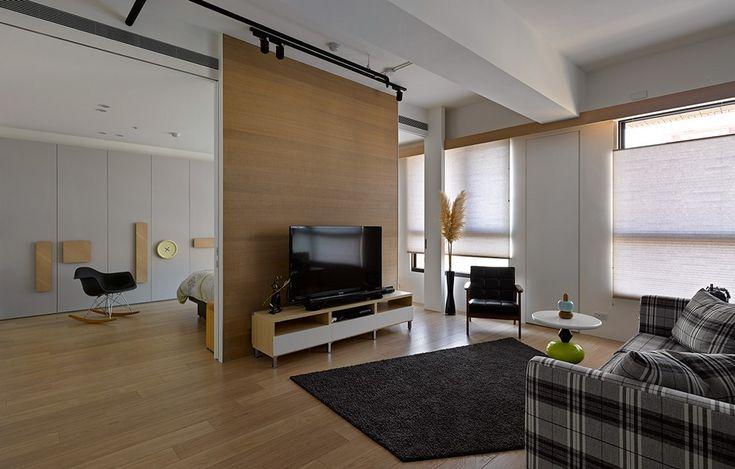 Стеллаж во всю стену комнаты: оригинальный интерьер квартиры