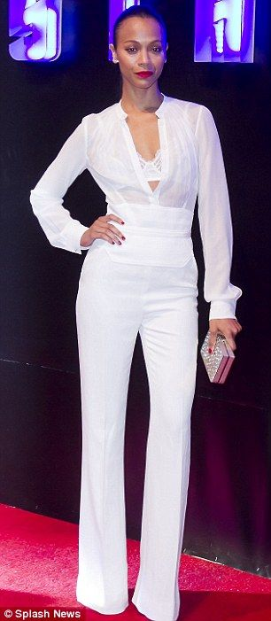 White hot: Zoe teamed the plunging top with a pair of matching trousers and a cummerbund