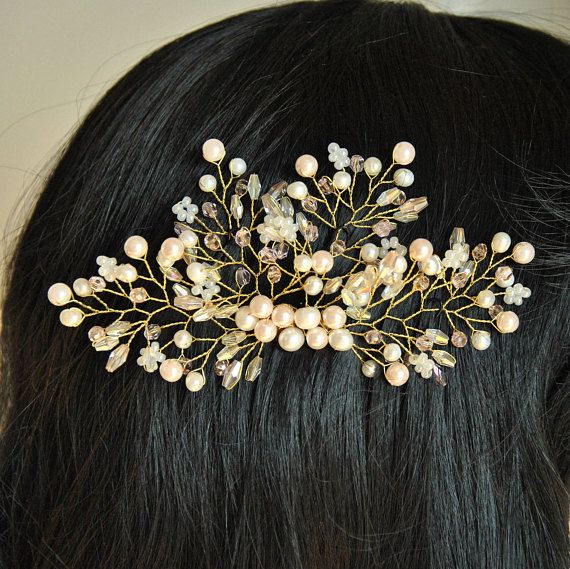 Breathtaking rose gold wedding hair piece. This blush bridal hair comb is rich in beautiful rose and ivory pearl beads, rose crystal beads that will allow this bridal hair accessory shining mysteriously in your hair. The branches of this bridal hair brooch are flexible that will
