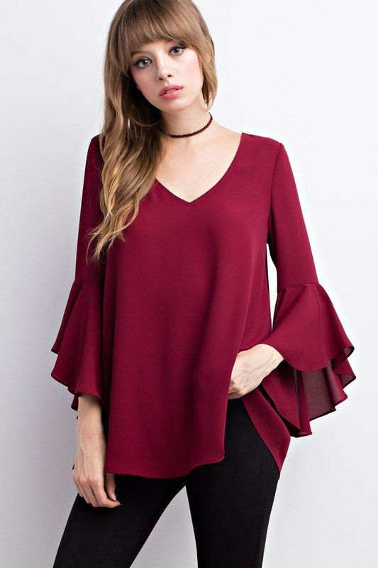 This ruffled bell sleeve top is a fantastic piece for fall! You are sure to fall in love with this beauty! This top features a V-neckline, ruffle bell sleeves, a T-back with long sleeves. You can thro