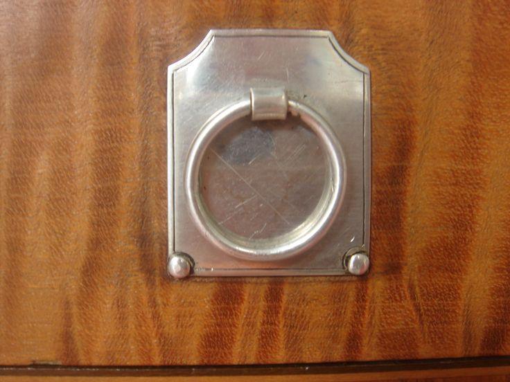 Irish Silver drawer pull on James Hicks cabinet.