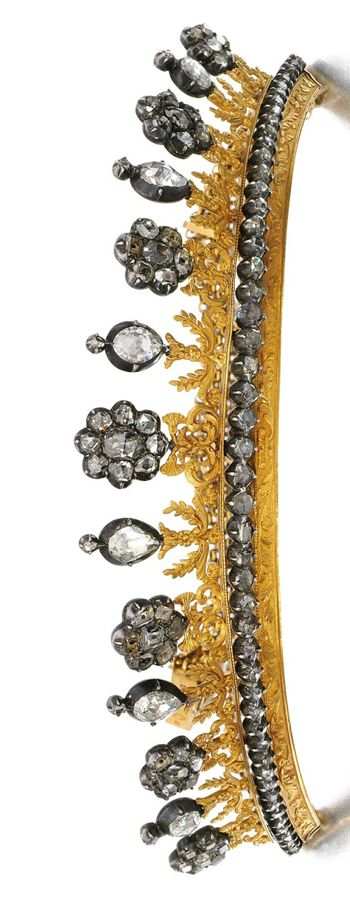 Gold and diamond tiara/ necklace, early 19th Century, The chased gold frame supporting a row of pinched collet-set table-cut and rose diamonds, to a surmount with floral and foliate gold work, capped with similarly cut stones, each side later set with rows of fine link chains allowing tiara to be worn as necklace. Sotheby´s