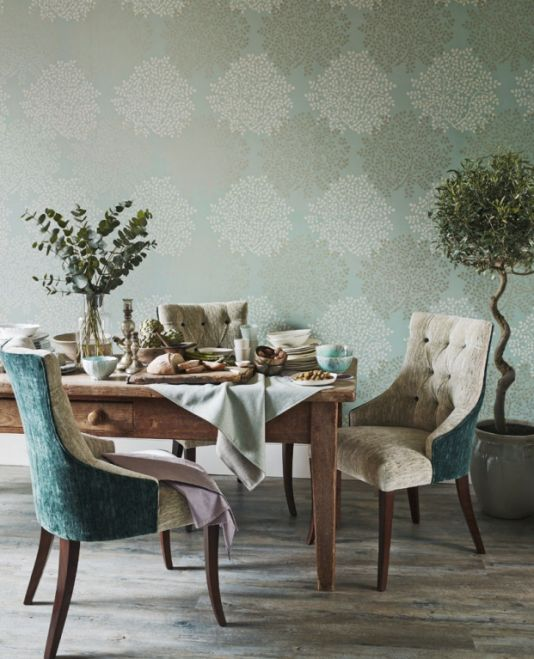 Lindos Vinyl Wallpaper A contemporary vinyl wallpaper designed with an array of bud-like foliage printed in reflective silver and cream on stone.