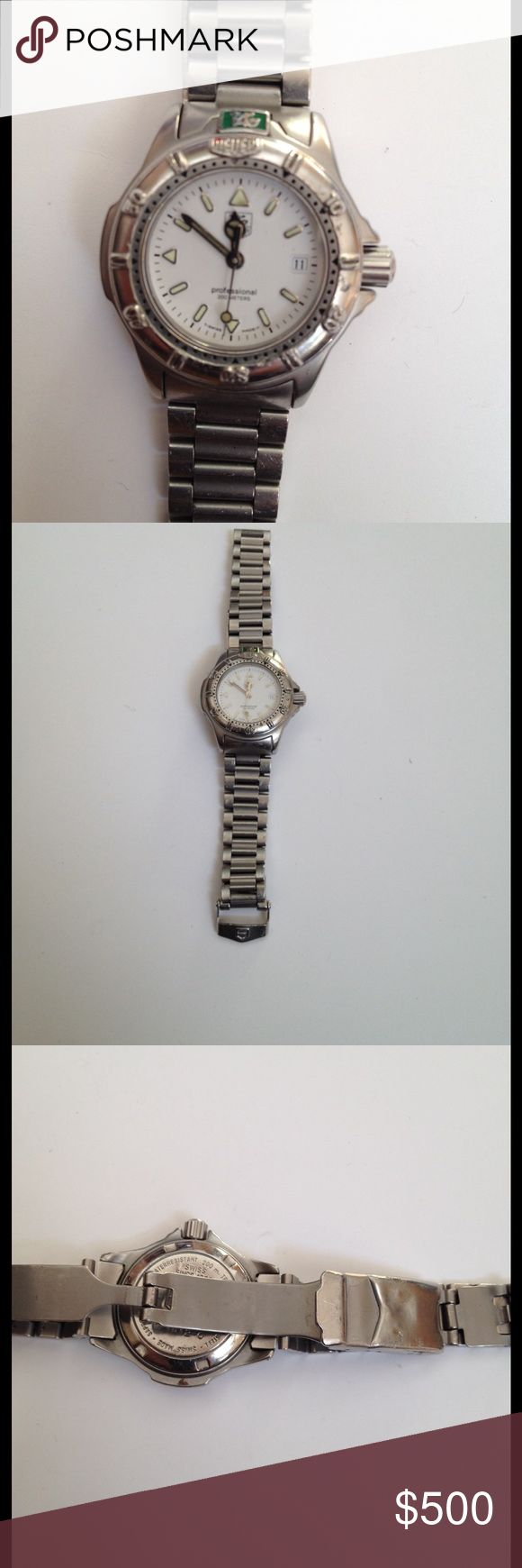 Tag Heuere Professional W-1410 Swiss 200 m Watch Guaranteed Authentic womens TAG HEURE watch WF 1412-0. Professional 200 Meters.  Amazing deal, AS IS, priced to sell! Brushed stainless steel. Movement Quartz, Case Steel, Case diameter 26 x 9 mm, Thickness 9 mm, Sapphire Glasw, White Dial, Date, Bracelet Stainless, Fold clasp. Links were removed, will best fit smaller to average wrist. Needs battery. Loved and well worn, shows use and wear from normal use. Deployment clasp has puppy bite…
