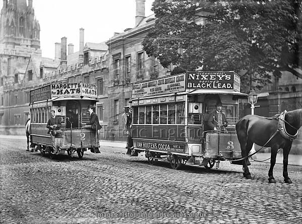 HIGH STREET, Oxford, Oxfordshire. Two horse-drawn trams passing in the street with advertising panels attached to the roofs. Magdalen Bridge was widened in 1899 by the Oxford Local Board to accommodate horse-drawn trams, but by 1913 motor buses had made their appearance. Photographed by Henry Taunt in c. 1905.