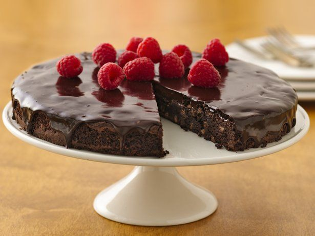 Gluten Free Brownie Ganache Torte with Raspberries. The perfect treat for fudge lovers.