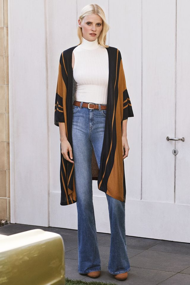 Supermodel Lara Stone brings back the distinctive spirit of the 70s in this season's musthave: flared jeans! │ H&M New Elegance