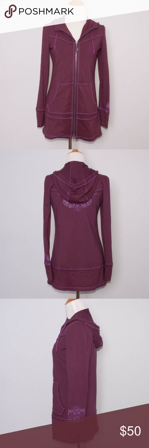 """Athleta Sphinx Hoodie and Yoga Pants Size: Hoodie is XXS and pants are XSP  """"Sphinx Hoodie and Yoga Pants"""" in """"Grape Jam""""  Full zip and kangaroo front pocket on the jacket  Floral design on sleeve cuffs and back of jacket  Drawstring waist pants  57% Cotton, 38% Modal, 5% Spandex  Machine wash  Made in Vietnam  Measurements:  Jacket  Bust: 34""""  Waist: 30""""  Sleeve Length: 24""""  Overall Length: 28""""  Pants  Waist: 26""""  Hips: 35""""  Inseam: 29""""  Overall Length: 35""""  Condition:  Hoodie and pants are…"""