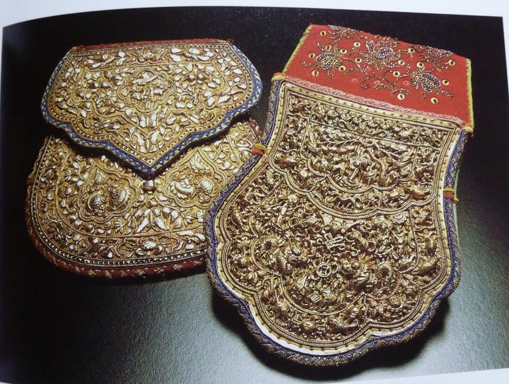 Straits Chinese purses from Malacca, Malaysia, inserted into the wedding belts of the bride (left) and the groom (right)